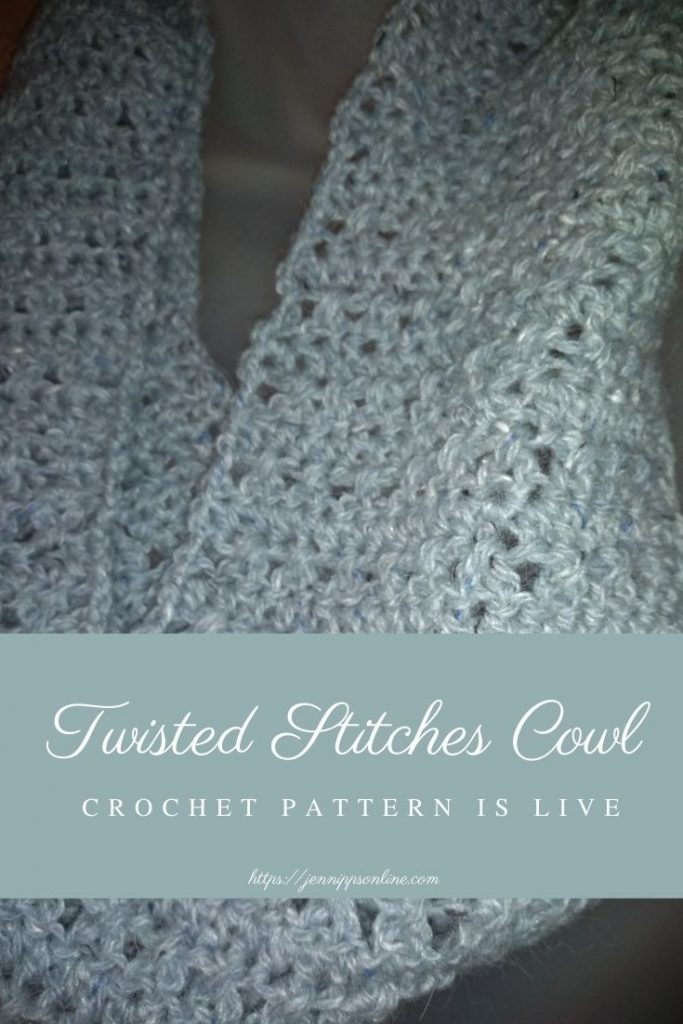 """Pinterest graphic: Close-up of the Twisted Stitches Cowl. A light blue box with script covers part of the cowl. It says, """"Twisted Stitches Cowl crochet pattern is live."""""""