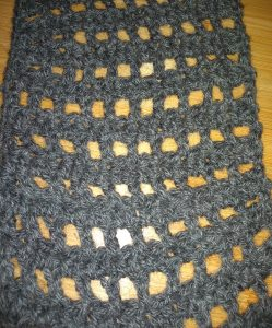 Cowl made using crochet recipe discussed in the post. Gray yarn in a grid pattern.
